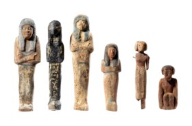 FOUR EGYPTIAN WOOD SHABTIS AND TWO WOOD FIGURES