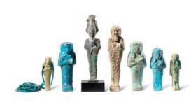 SIX EGYPTIAN FAIENCE SHABTIS AND A BRONZE OSIRIS