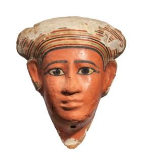 AN EGYPTIAN PAINTED WOOD MUMMY MASK
