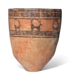 A LARGE PERSIAN POTTERY JAR