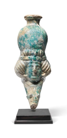 A LATE PARTHIAN OR EARLY SASANIAN TURQUOISE GLAZED POTTERY R