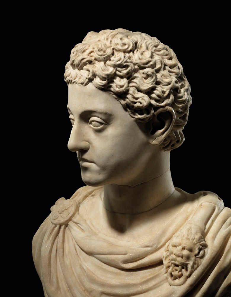 Commodus's smooth features, gazing eyes, youthful appearance and heavily drilled, short ringlets of hair all suggest grace and immortality
