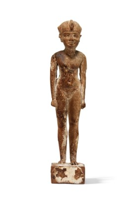 AN EGYPTIAN WOOD FIGURE OF A YOUNG KING AS HARPOCRATES