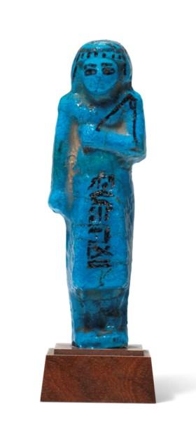 AN EGYPTIAN BRIGHT BLUE FAIENCE OVERSEER SHABTI FOR THE HIGH