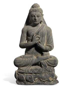 A GREY SCHIST FIGURE OF A SEATED BUDDHA