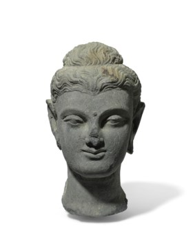 A GREY SCHIST HEAD OF THE BUDDHA