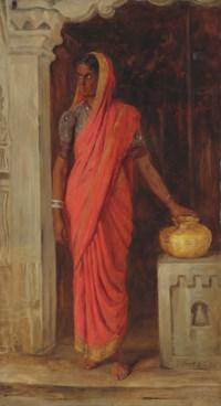 An Indian woman wearing a red sari