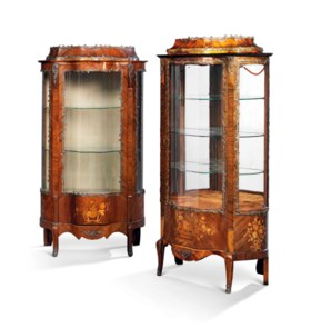A MATCHED PAIR OF FRENCH BRASS-MOUNTED ROSEWOOD MARQUETRY SERPENTINE VITRINES