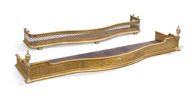 TWO LATE VICTORIAN BRASS SERPENTINE FENDERS