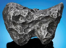 A CAMPO DEL CIELO — PALM-SIZED COMPLETE IRON METEORITE WITH