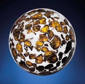 A SEYMCHAN METEORITE SPHERE—AN EXTRATERRESTRIAL CRYSTAL BA
