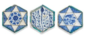 A GROUP OF THREE MAMLUK HEXAGONAL POTTERY TILES