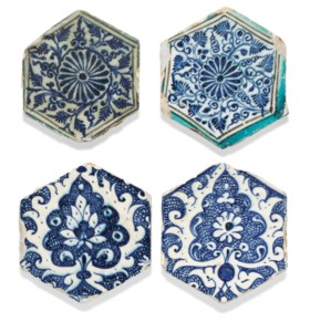 A GROUP OF FOUR MAMLUK HEXAGONAL POTTERY TILES
