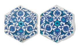TWO BLUE AND WHITE HEXAGONAL IZNIK TILES