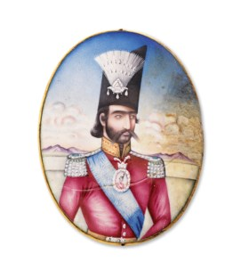 A QAJAR ENAMELLED GOLD PORTRAIT MEDALLION