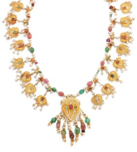 A FILIGREE AND GEM-SET GOLD NECKLACE