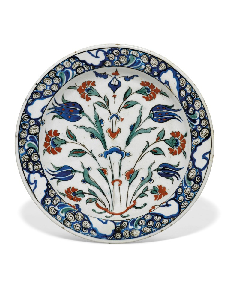 An Iznik pottery dish, Ottoman Turkey, circa 1590. 11 ¾ in (30 cm) diam. Estimate £7,000-10,000. This lot is offered in Art of the Islamic and Indian Worlds Including Oriental Rugs and Carpets on 26 April at Christie's in London