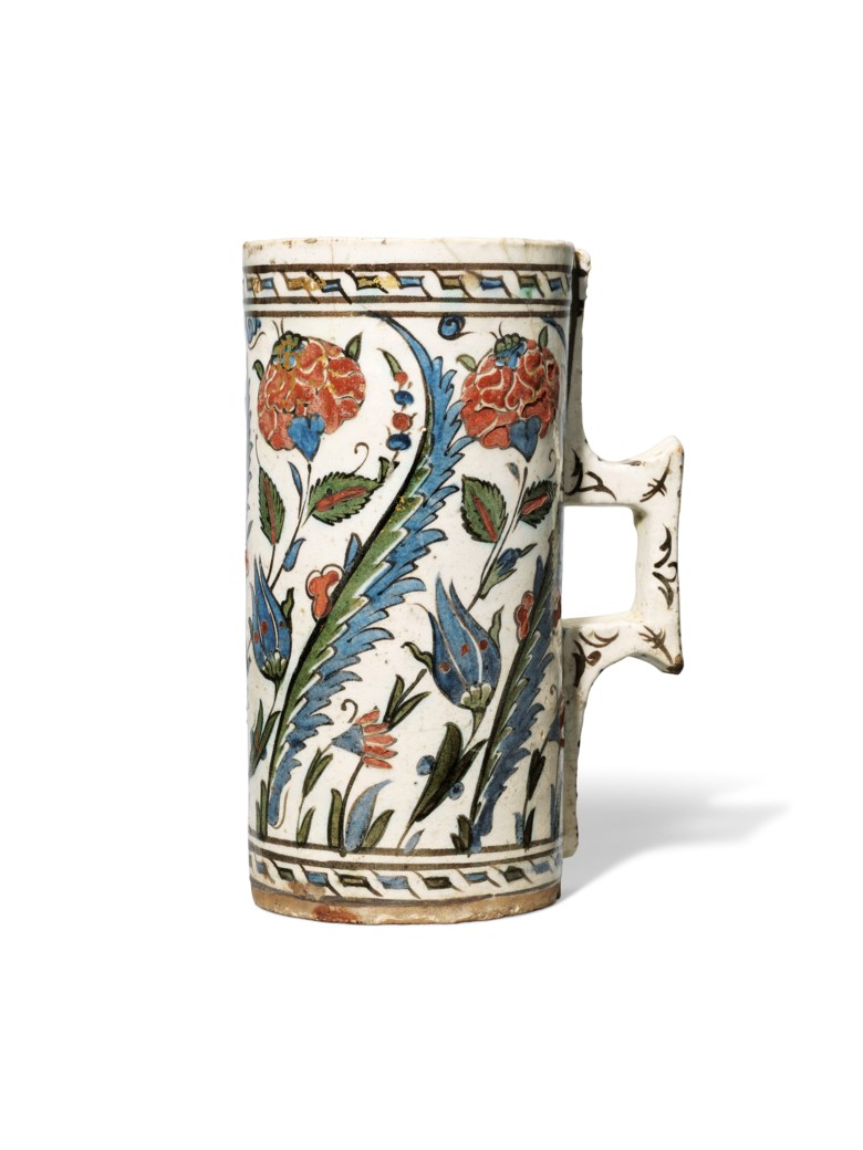 An Iznik pottery tankard, Ottoman Turkey, circa 1630. 8 ½ in (21.7 cm) high. Estimate £3,000-5,000. This lot is offered in Art of the Islamic and Indian Worlds Including Oriental Rugs and Carpets on 26 April at Christie's in London