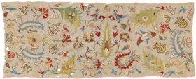AN EMBROIDERED FLORAL TEXTILE PANEL