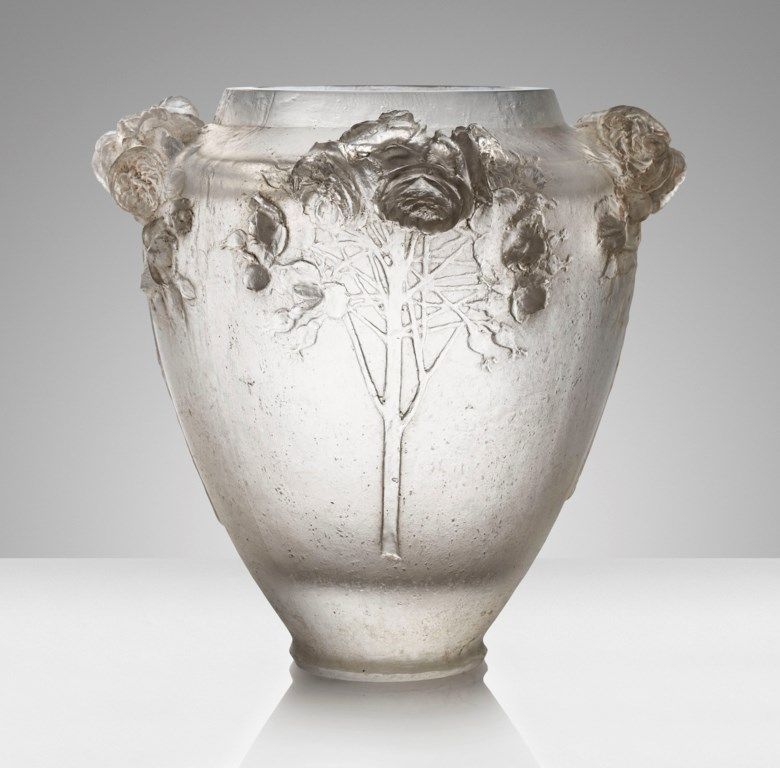 The largest René Lalique vase ever to be offered at auction 'Roses', a rare and exceptional cire perdue vase, No. CP 48, designed 1913. 12⅜  in (31.4  cm) high. Estimate £300,000-500,000. This lot is offered in Design on 17 October 2018 at Christie's in London
