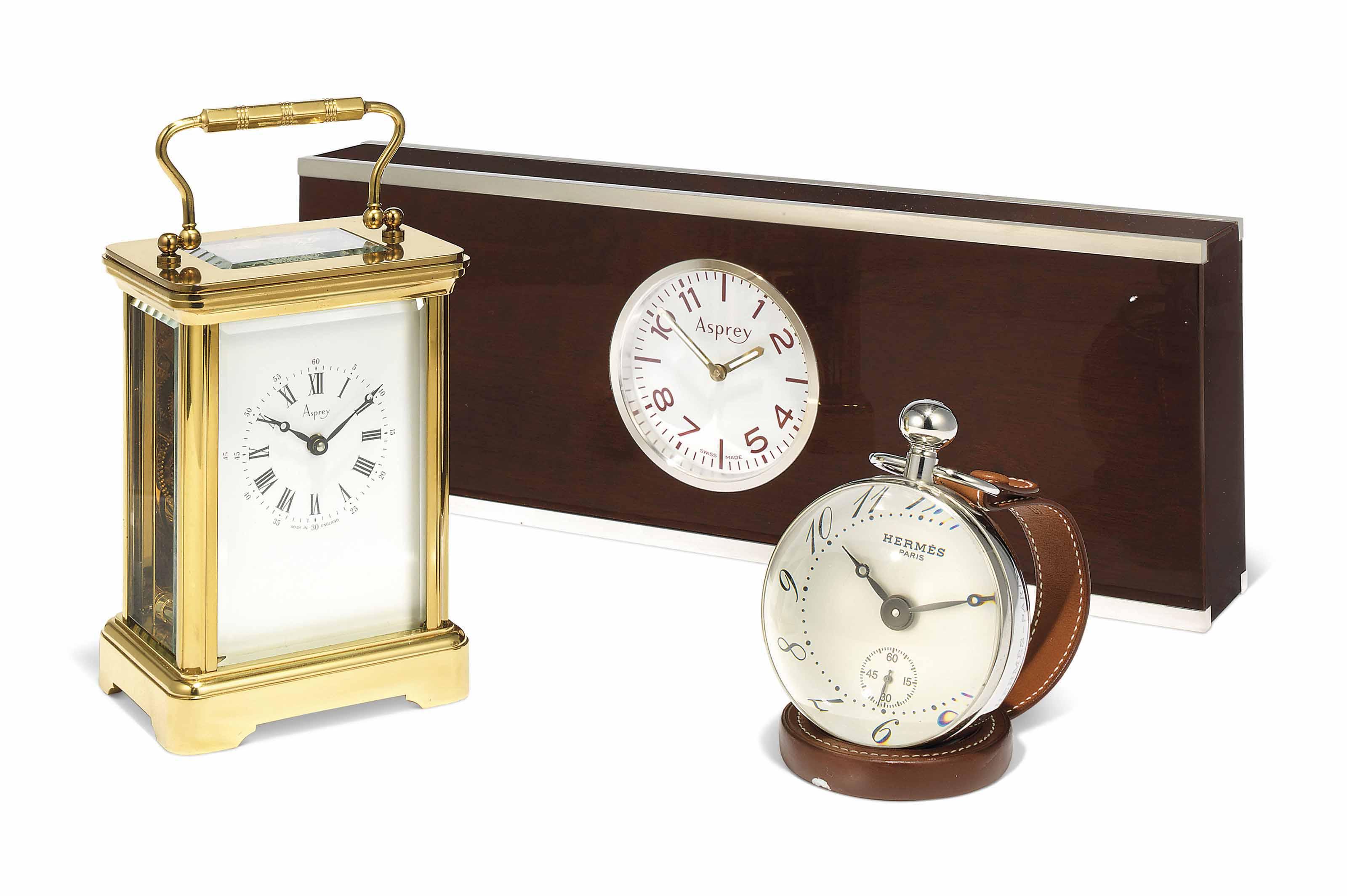 A GILT-BRASS CARRIAGE TIMEPIEC