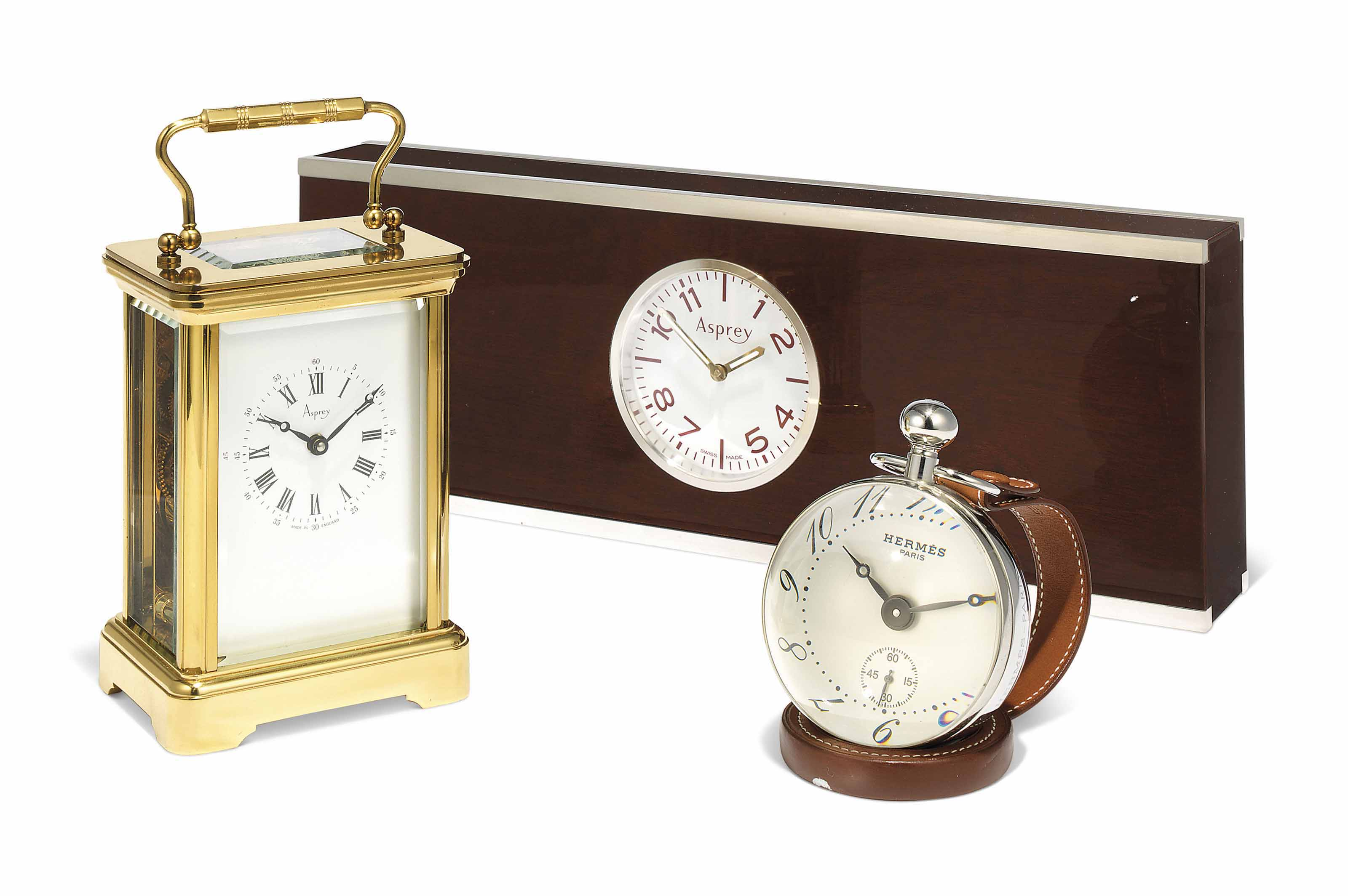 A GILT-BRASS CARRIAGE TIMEPIECE CLOCK
