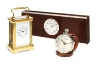A GILT-BRASS CARRIAGE TIMEPIECE CLOCK