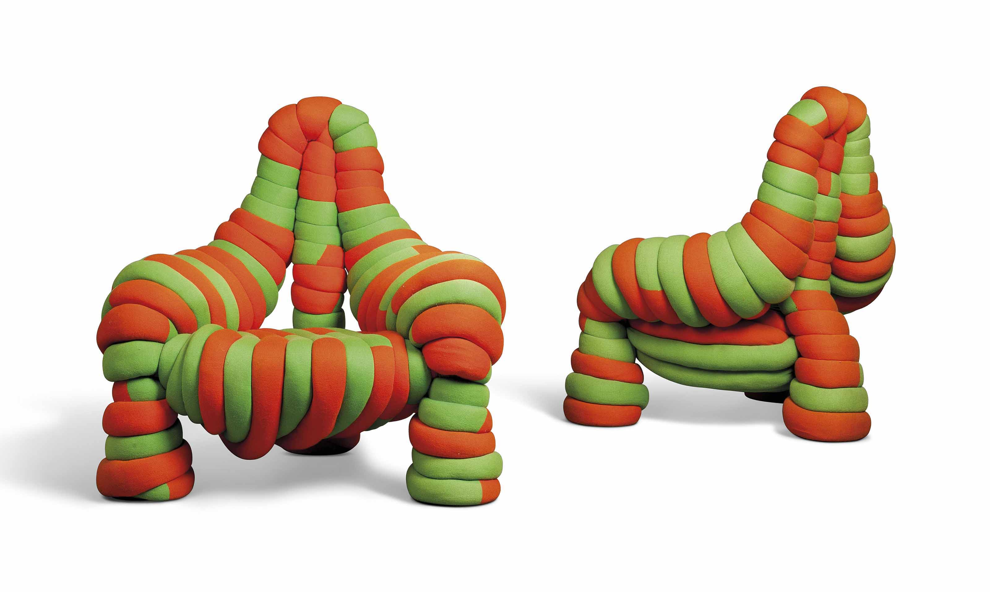 A PAIR OF ORANGE AND GREEN WOOL UPHOLSTERED THREE-LEGGED CHAIRS