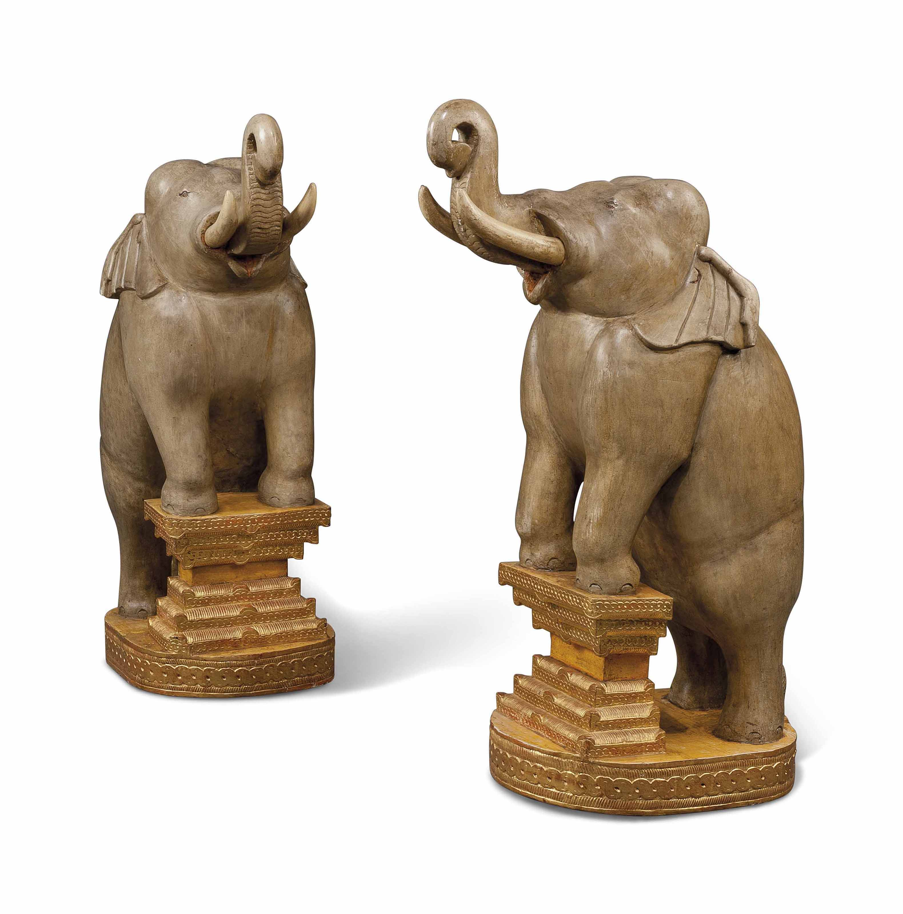 A PAIR OF PAINTED AND PARCEL-GILT HARDWOOD LARGE ELEPHANT FIGURES