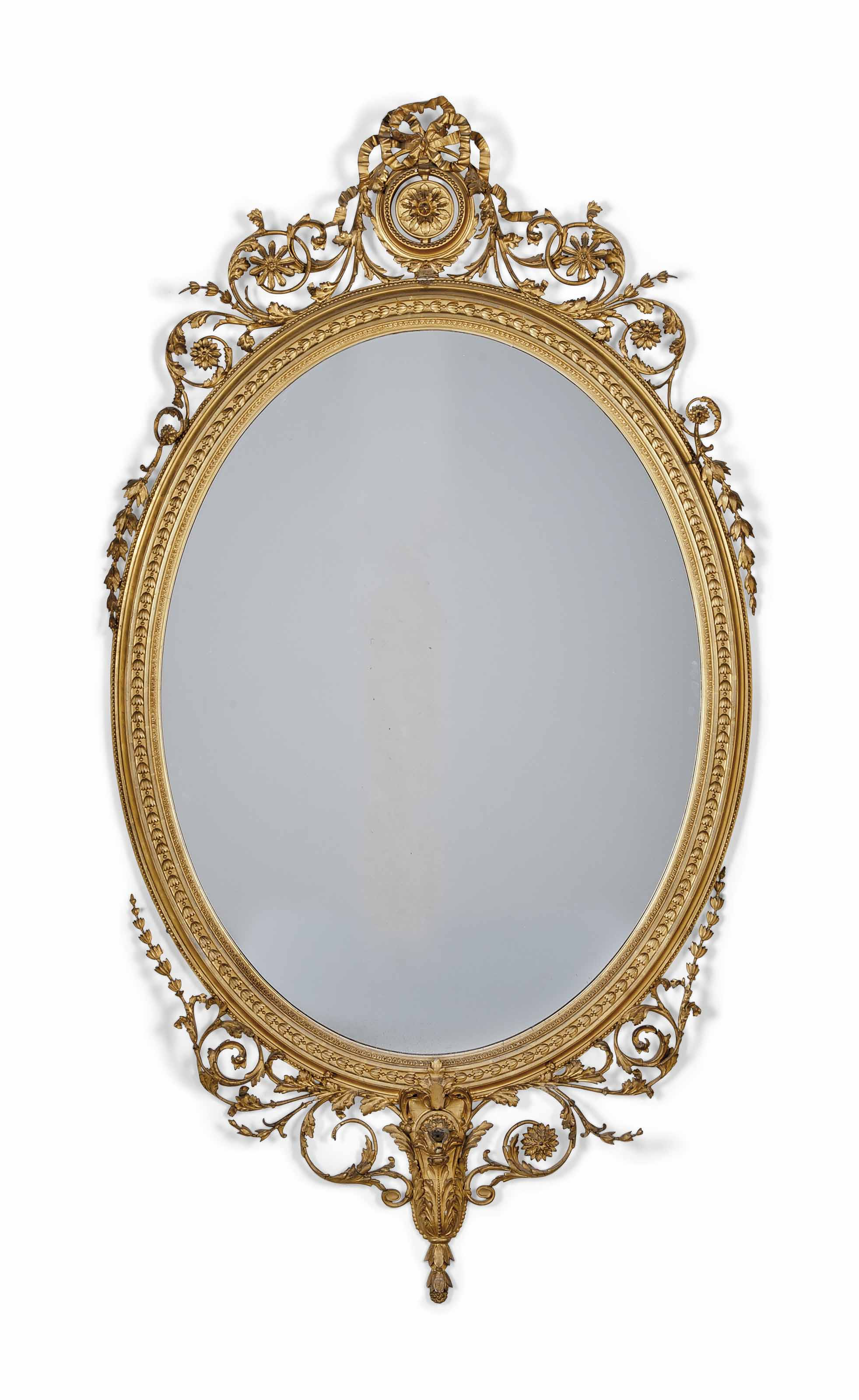 A GILTWOOD AND COMPOSITION OVAL MIRROR