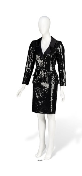 A NAVY WOOL DOUBLE BREASTED COAT AND SEQUINNED SMOKING SKIRT