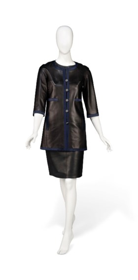 A BLACK LEATHER COAT, WAISTCOAT AND SKIRT
