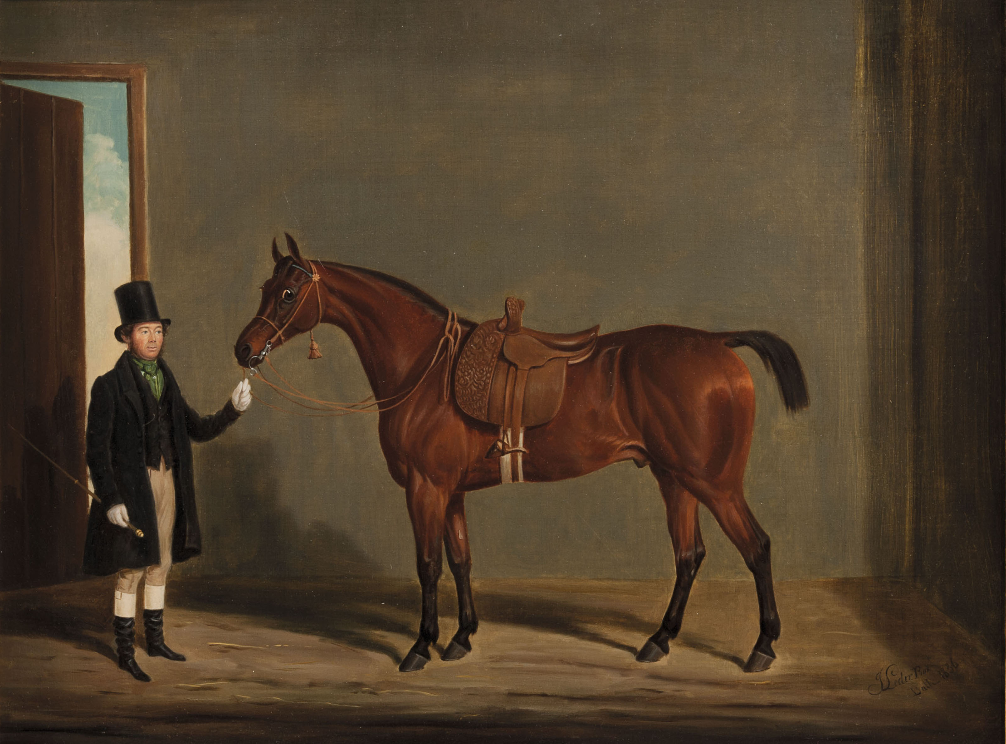 A chesnut stallion in a stable and his owner