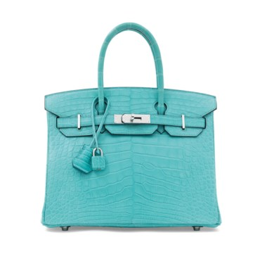 A matte bleu saint cyr alligator Birkin 30 with palladium hardware, Hermès, 2015. 30 w x 22 h x 15 d cm. Estimate £25,000-30,000. Offered in Handbags & Accessories on 12 June at Christie's in London Evoking seaside jaunts, this dreamy Birkin brings a touch of calm and serenity to any outfit.       .captiondesc { font-family LyonRegular, Arial, Helvetica,