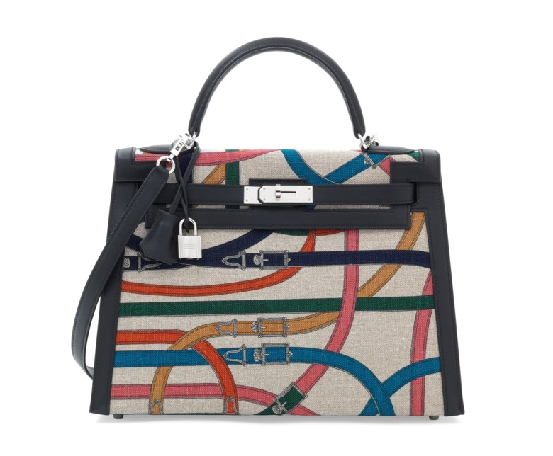 A limited-edition toile de camp cavalcadour and black swift leather sellier Kelly 32 with palladium hardware, Hermès, 2017. 32 w x 23 h x 10.5 d cm. Estimate £8,000-10,000. This lot is offered in Handbags & Accessories on 12 June 2018 at Christie's in London