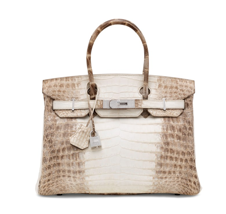 An exceptional, matte white Himalaya niloticus crocodile diamond Birkin 30 with 18k white gold & diamond hardware, Hermès, 2008. 30 w x 22 h x 15 d cm. Estimate £100,000-150,000. This lot is offered in Handbags & Accessories on 12 June 2018 at Christie's in London