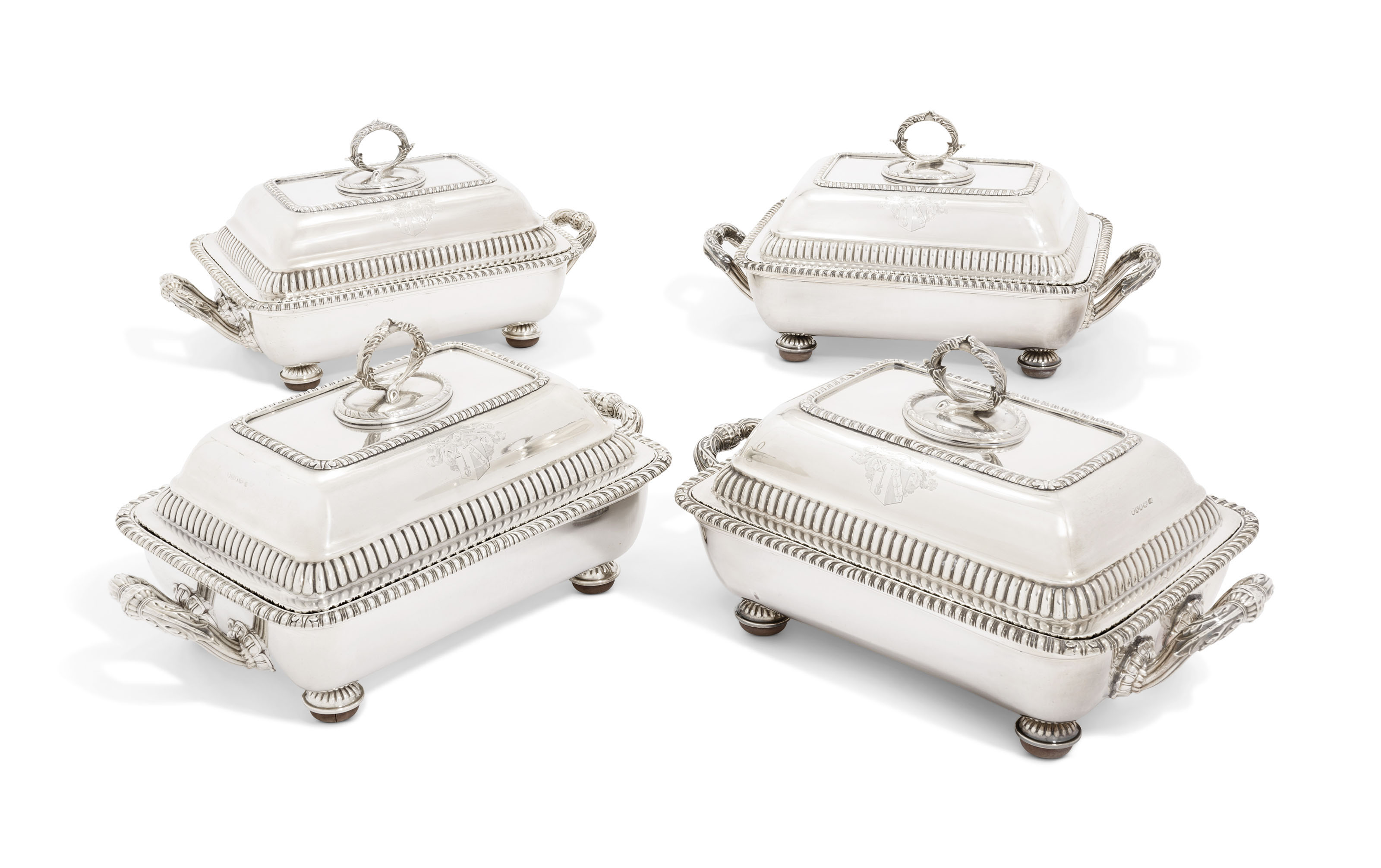 A SET OF FOUR GEORGE III SILVER ENTREE-DISHES AND COVERS ON OLD SHEFFIELD PLATED STANDS