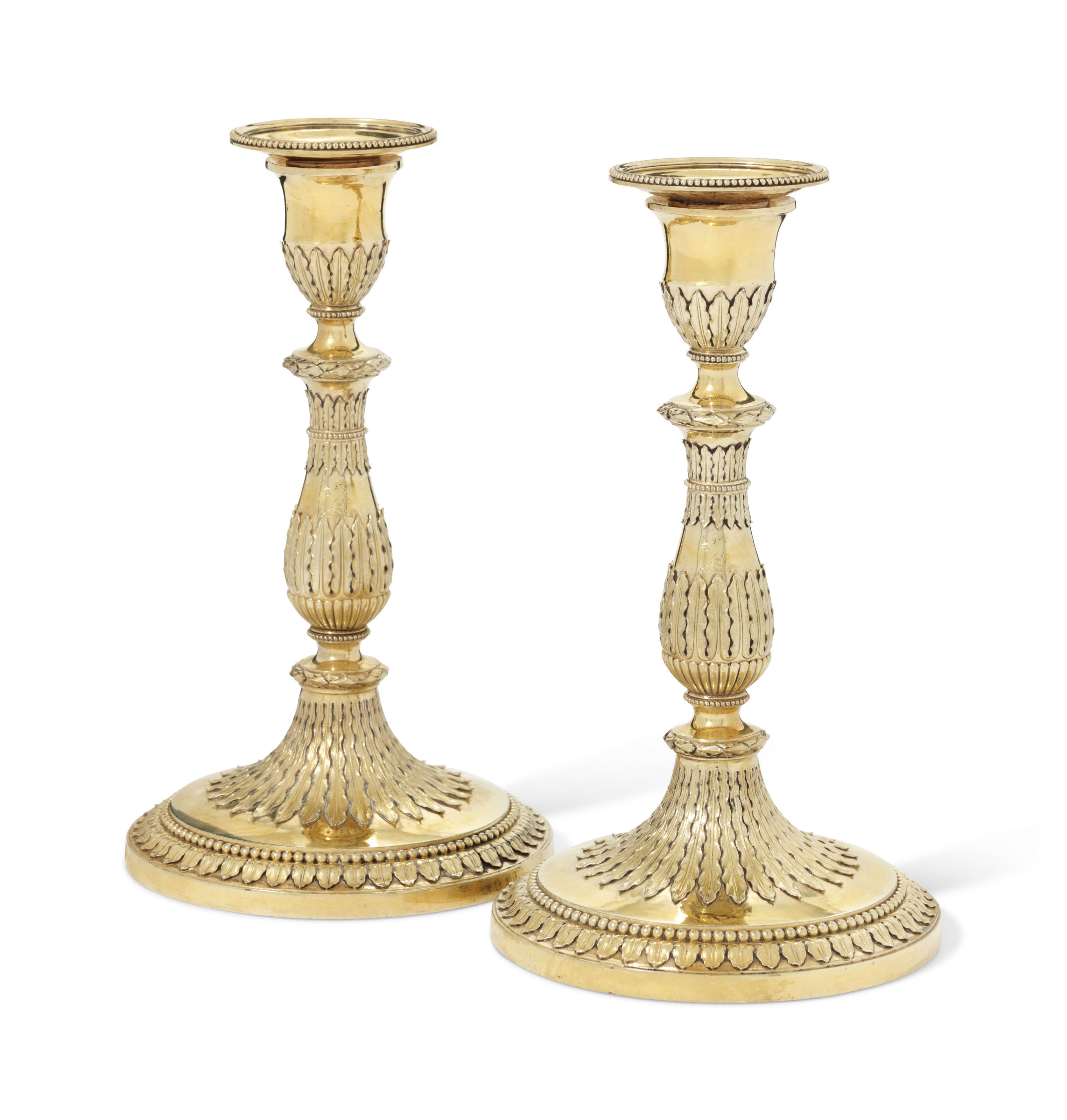 A PAIR OF GEORGE III SILVER-GILT CANDLESTICKS
