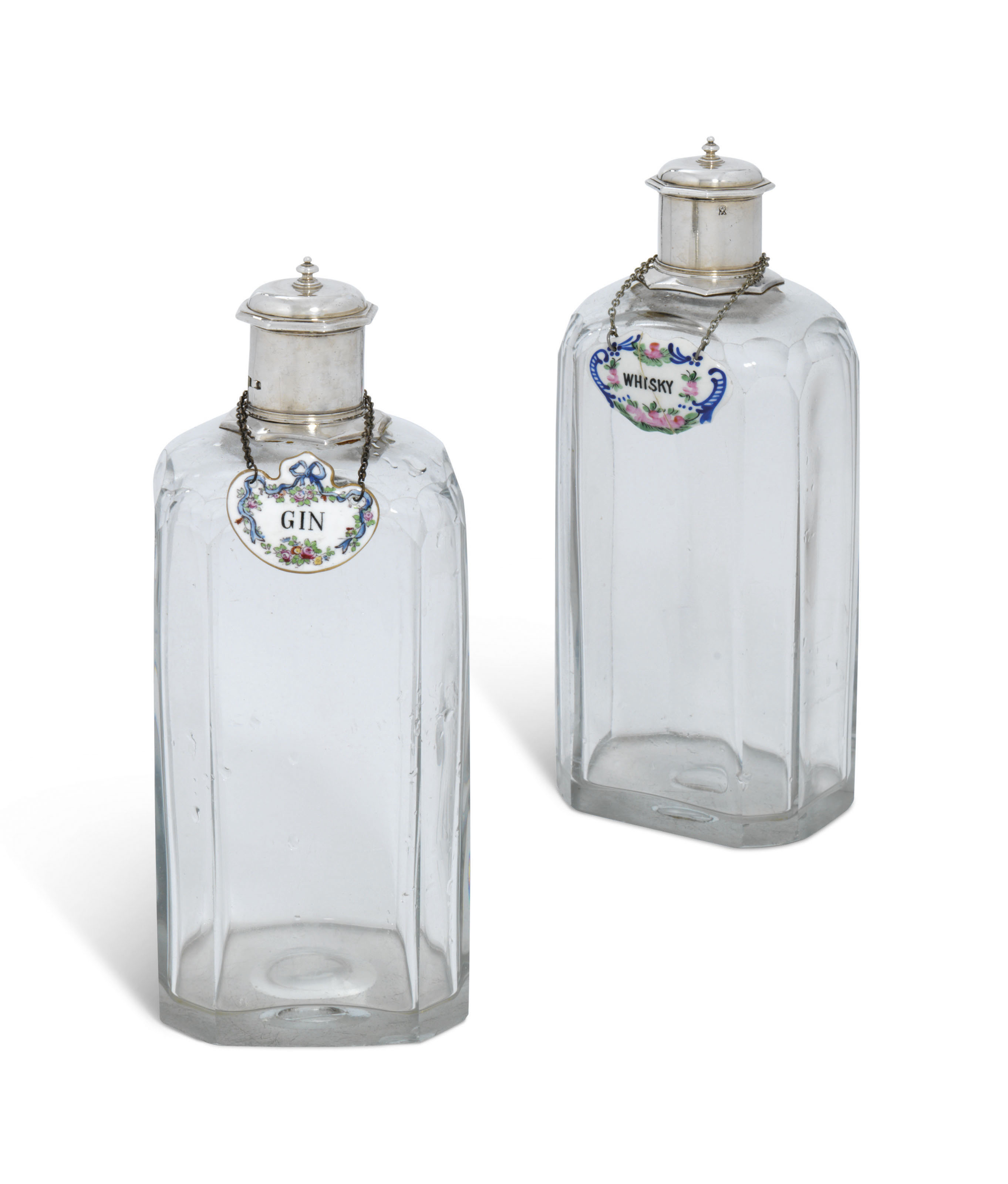 A PAIR OF SILVER-MOUNTED GLASS DECANTERS