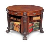 A REGENCY MAHOGANY, EBONY AND EBONISED LIBRARY DRUM TABLE