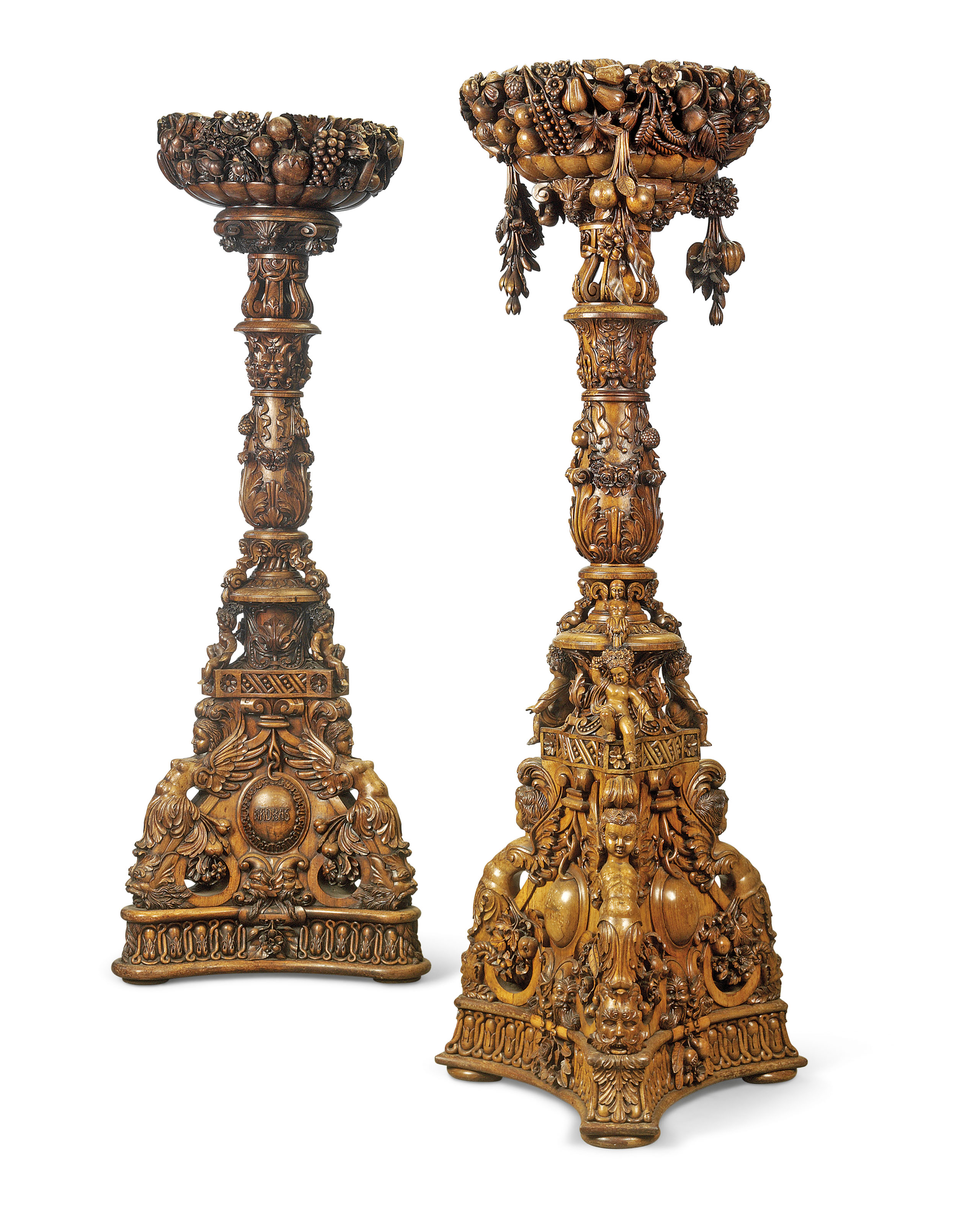 A NEAR PAIR OF INDIAN ROSEWOOD TORCHERES