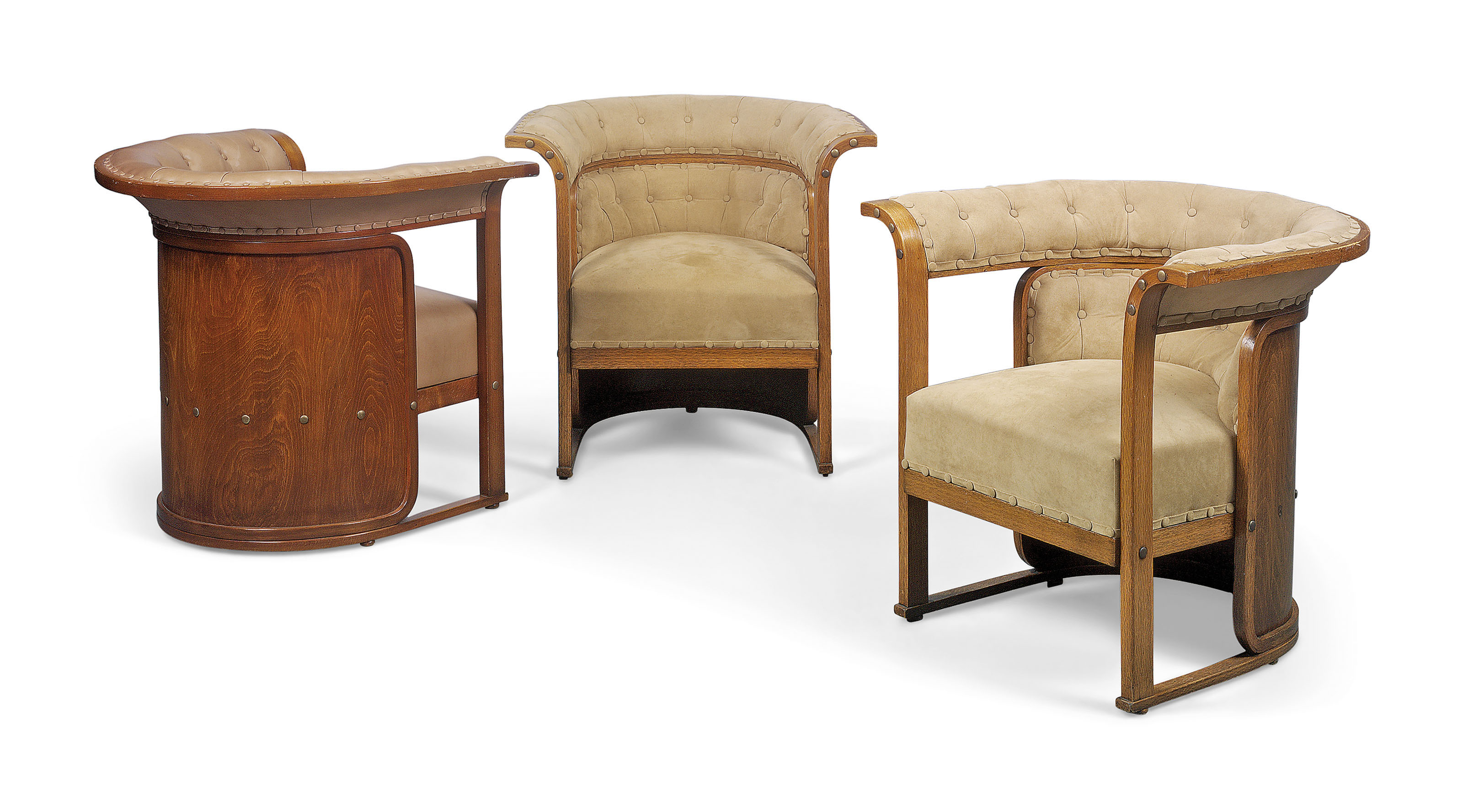 A MATCHED SET OF THREE 'BUENOS AIRES' BEECHWOOD AND OAK ARMCHAIRS