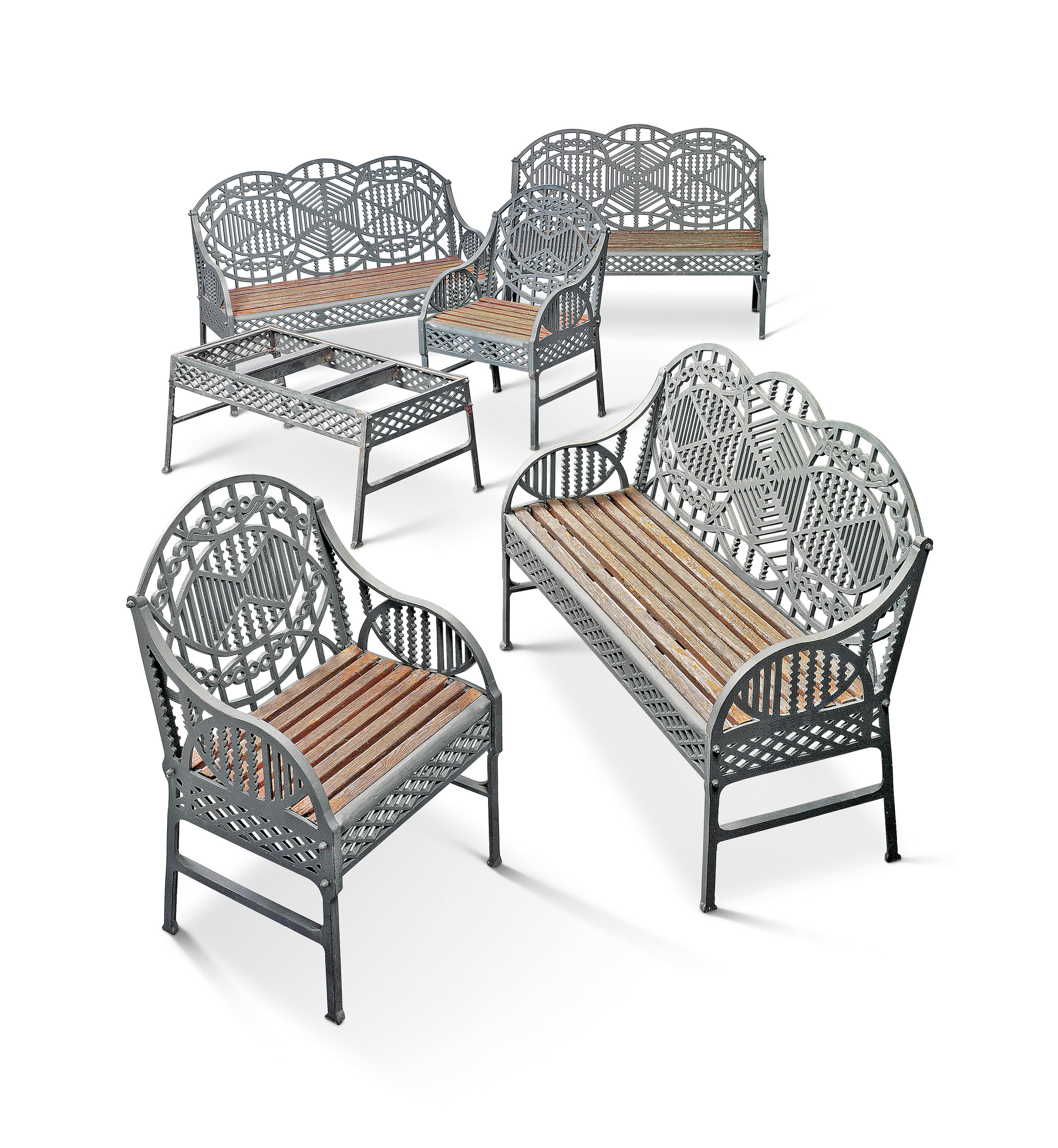 A suite of green painted cast iron garden furniture