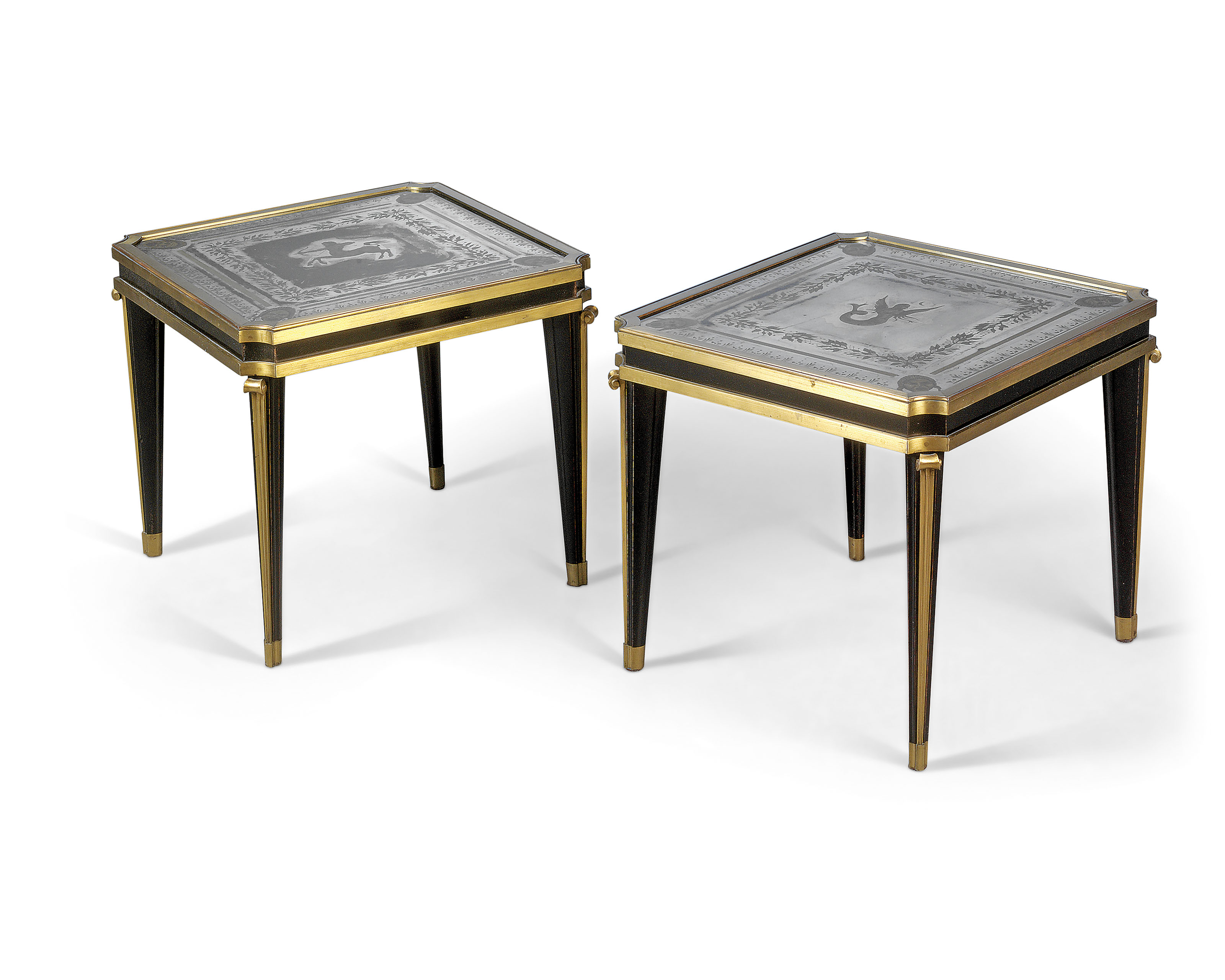 A PAIR OF GILT-BRONZE, EBONISED AND VERRE EGLOMISE OCCASIONAL TABLES