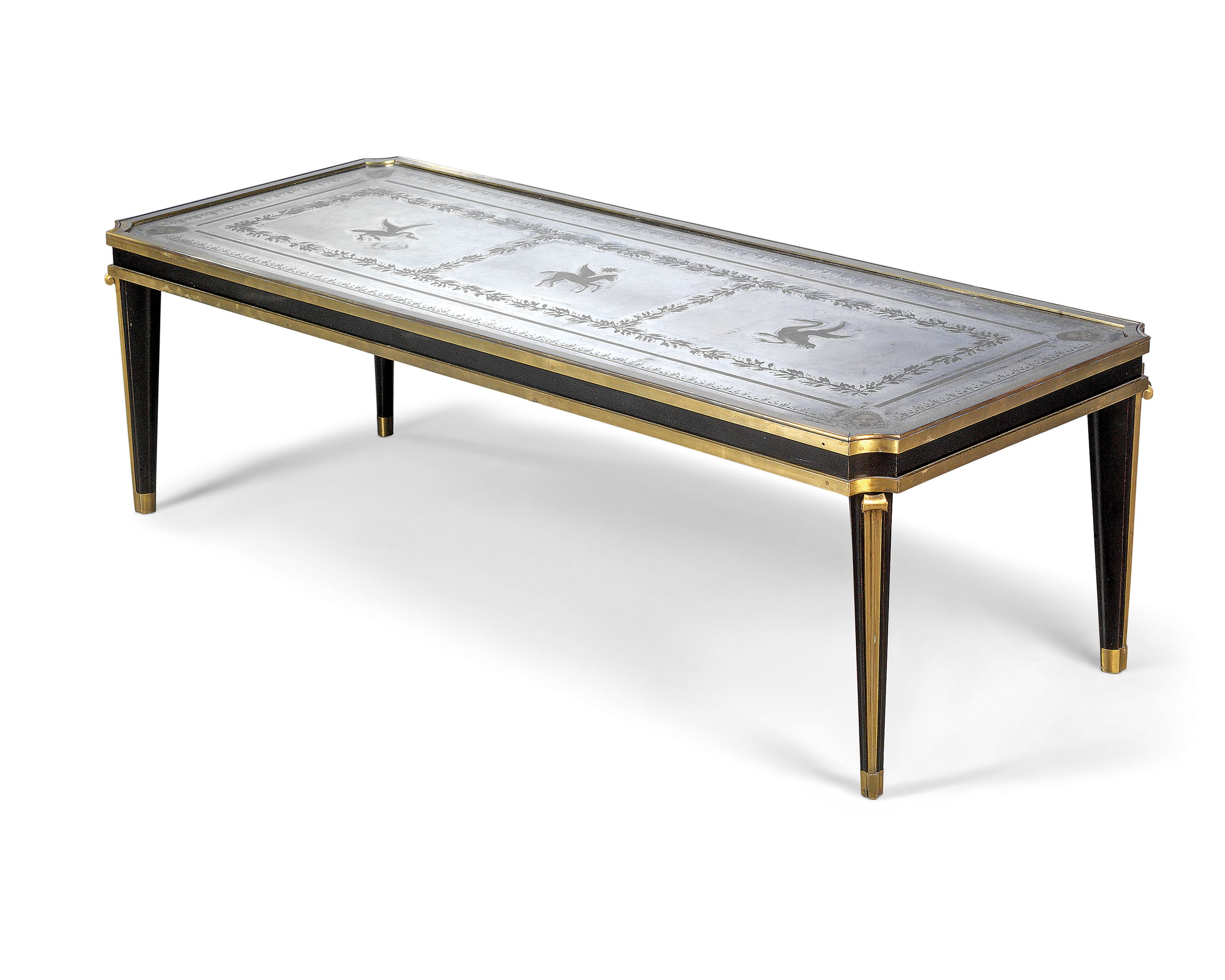 A GILT-BRONZE, EBONISED AND VERRE EGLOMISE OCCASIONAL TABLE