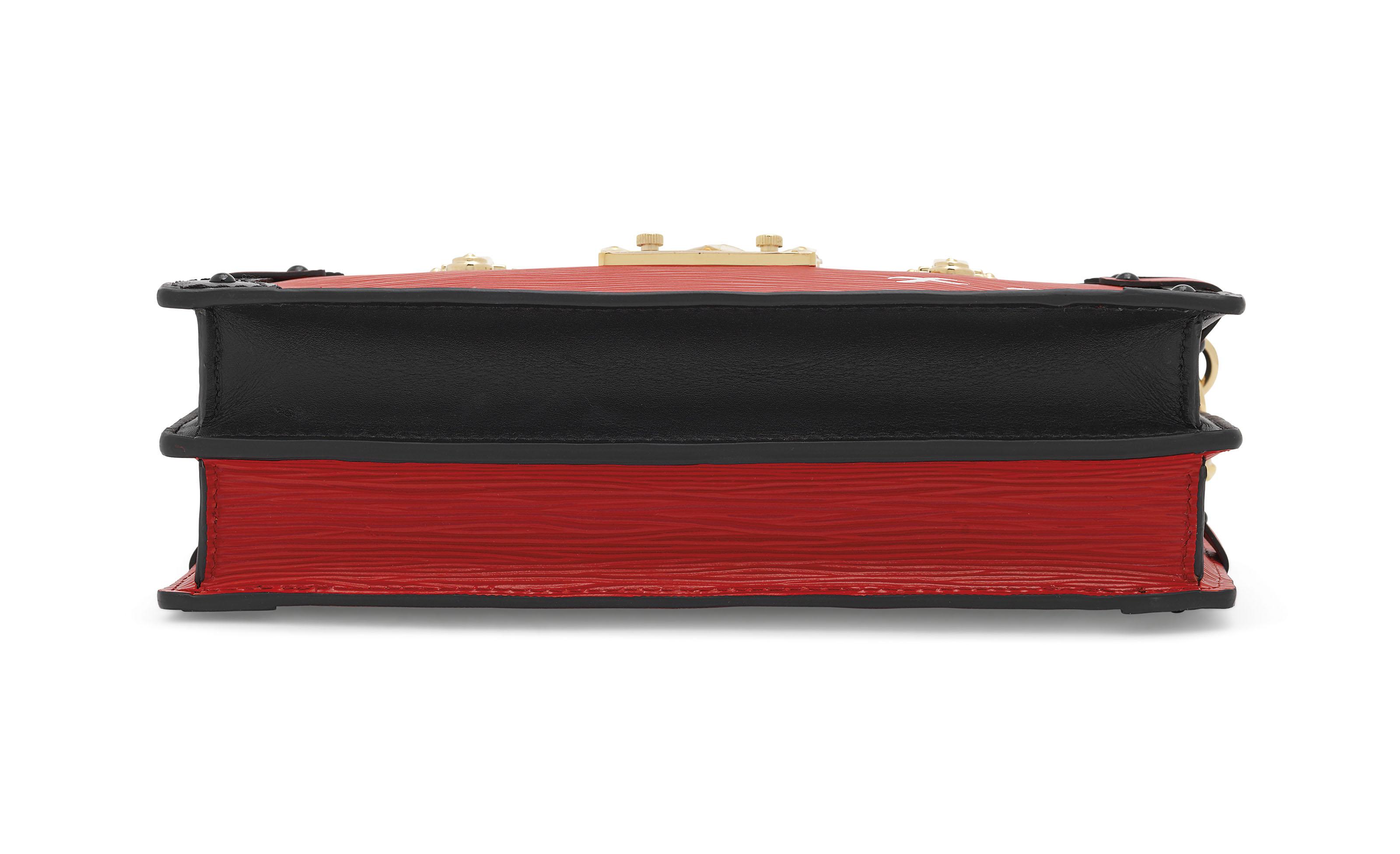 A RED ÉPI LEATHER TRUNK CLUTCH