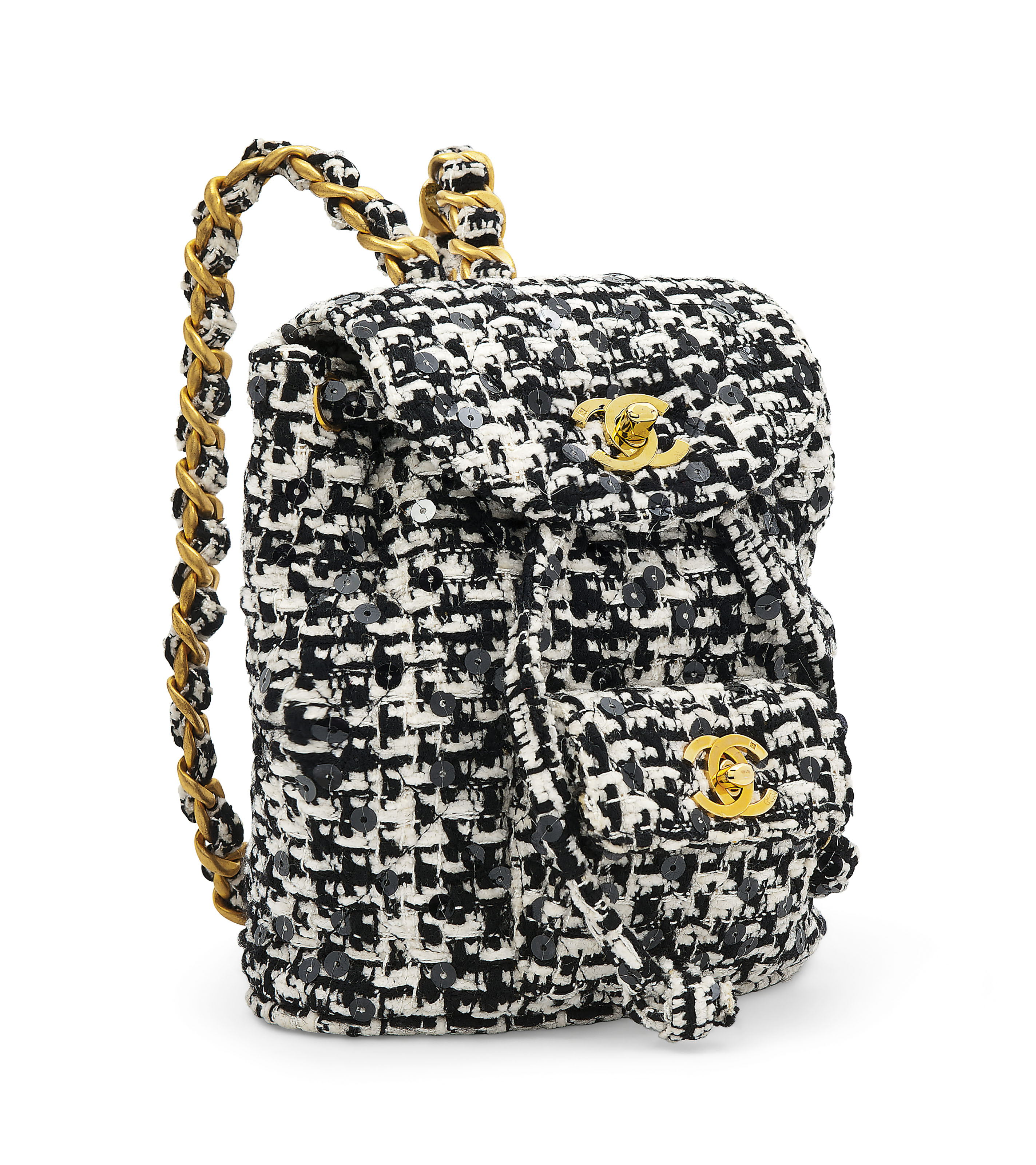 223a76cdc50d A BLACK & WHITE TWEED BACKPACK WITH GOLD HARDWARE | CHANEL, 1994 ...
