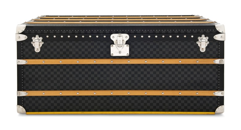 A graphite Damier Canvas Courrier 110 steamer trunk with silver hardware, Louis Vuitton, 2010s. 110 w x 55 h x 57 d cm. Estimate £8,000-10,000. This lot is offered in Handbags & Accessories on 12 December 2018 at Christie's in London