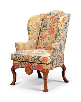 A GEORGE I WALNUT AND MARQUETRY WING ARMCHAIR