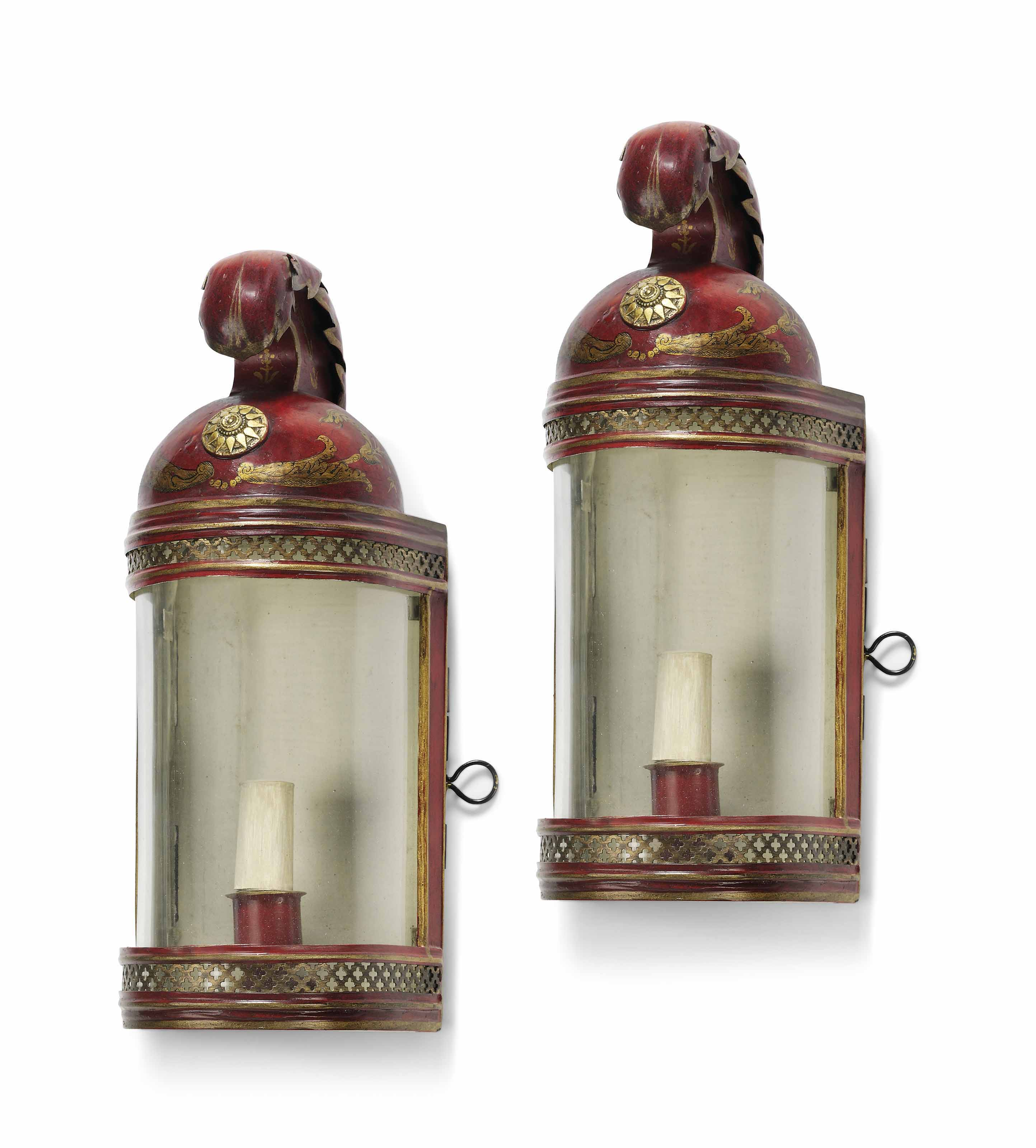 A PAIR OF RED AND GILT-PAINTED TOLE HELMET-SHAPED WALL LANTERNS
